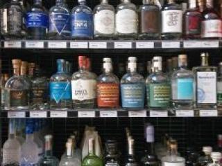 well stocked gin shelves in Tasmanian bottle shop