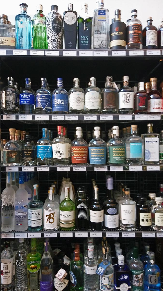 well stocked gin shelves in Tasmanian bottle shop