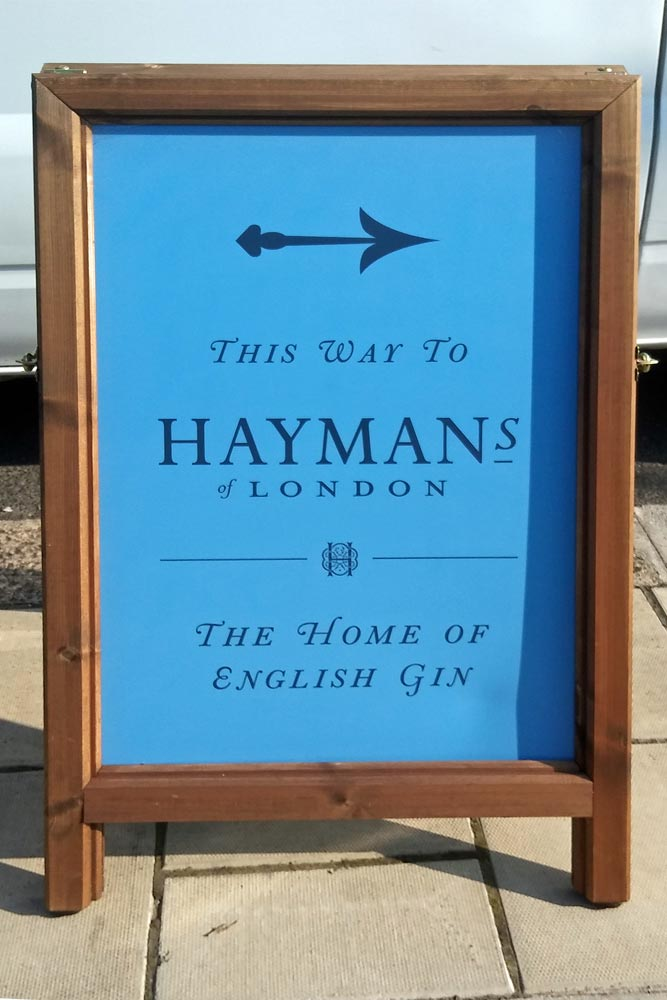 sandwich board pointing to the Home of English Gin