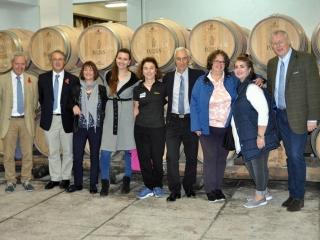 CRG team with guide Eva Figueira in cellar at Adega de Pegoes