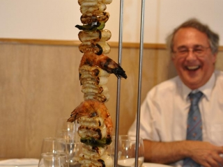 Nick surveys a cuttlefish skewer during a monumental lunch at Pegoes, Portugal
